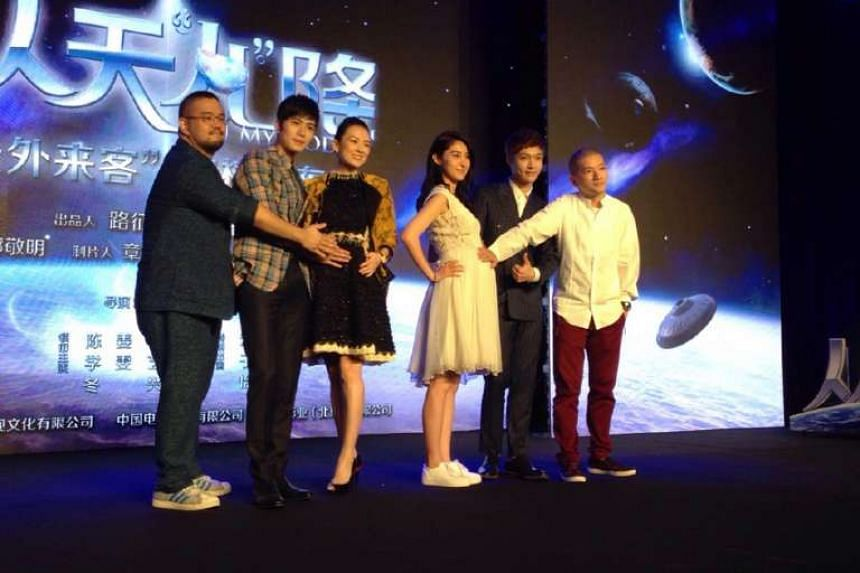 Zhang Ziyi and actress Jiang Wen (in white) posing as pregnant women while promoting Oh My God in Beijing this month with cast and crew.