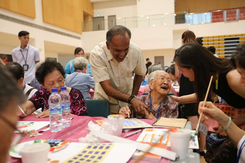Mdm Lim Beak, 108 years old, a senior from Thye Hua Kwan Seniors Activity Centre is greeted by Mr K. Shanmugam at the event.
