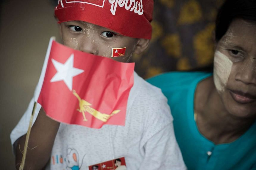 A young supporter of National League for Democracy chairperson Aung San Suu Kyi (not pictured) waits for her arrival during a rally in Thanlyin Township, on the outskirts of Yangon on Aug 21, 2015.