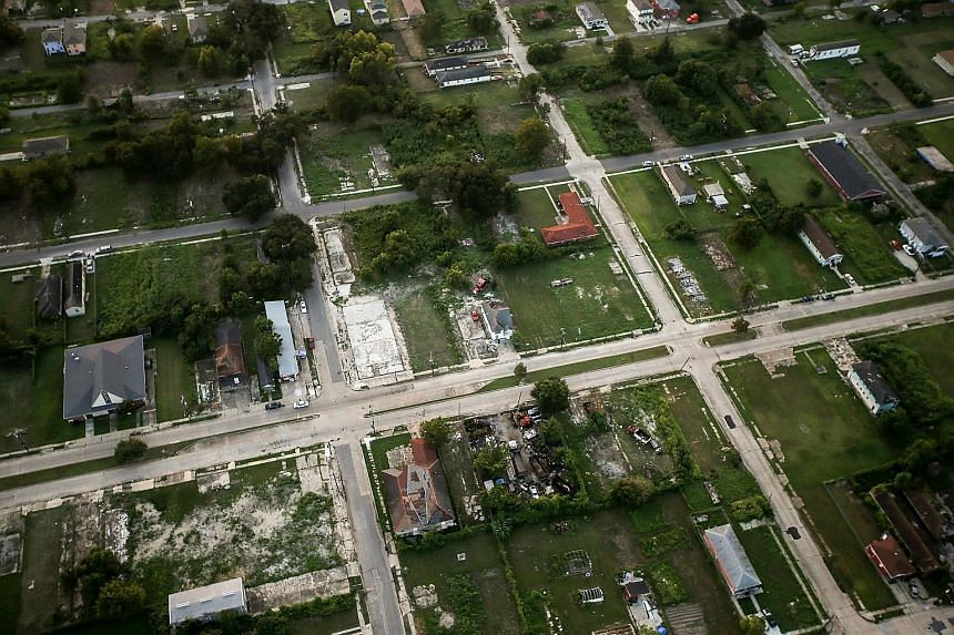 Homes are mixed with vacant lots in the Lower Ninth Ward on Aug 24, 2015 in New Orleans, Louisiana.