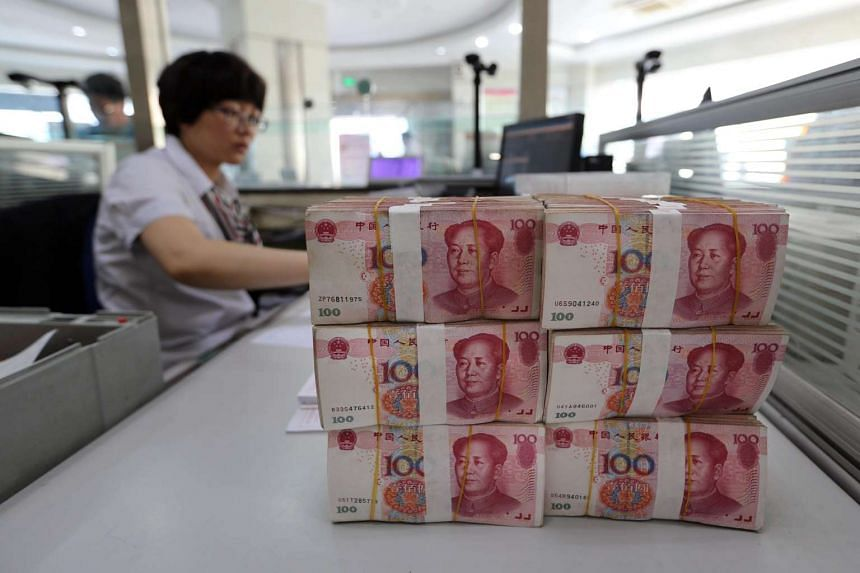 China's yuan declined to a two-week low after the central bank lowered borrowing costs in a surprise move.