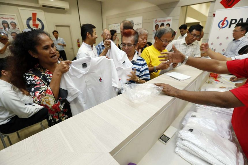 PAP volunteers collecting their polo t-shirts at the Bedok Branch.