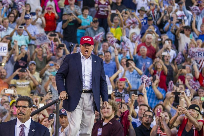 US Republican presidential candidate Donald Trump takes the stage at Ladd-Peebles Stadium on Aug 21, 2015 in Mobile, Alabama.