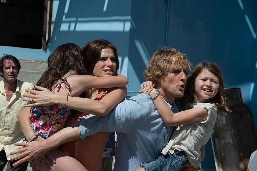 Actor Owen Wilson plays Jack Dwyer, an American expatriate who finds himself caught in a coup, alongside his wife Annie (Lake Bell) and young daughters Lucy (Sterling Jerins) and Beeze (Claire Geare).