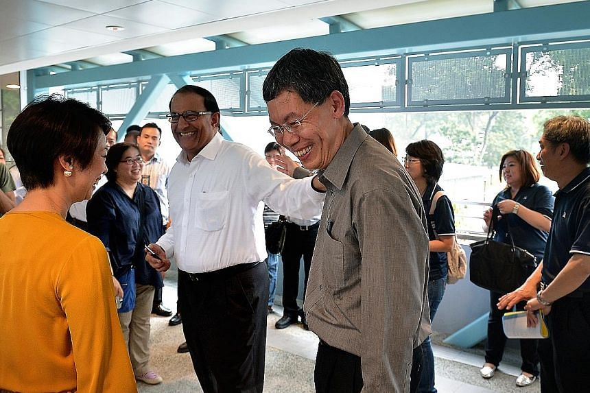 Transport Minister Lui Tuck Yew with West Coast GRC MPs S. Iswaran and Foo Mee Har, visiting the new link bridges yesterday.