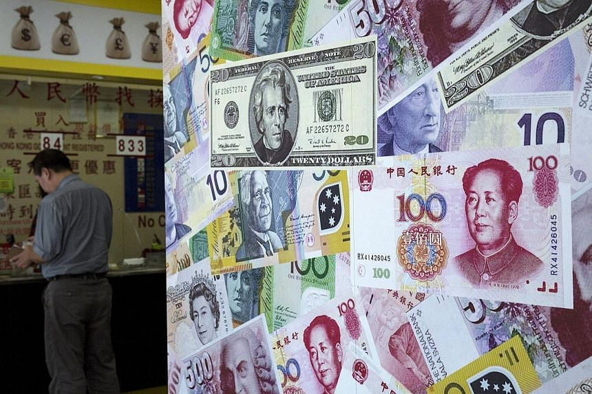 A foreign exchange store in Hong Kong. The Singdollar has weakened, following the devaluation of China's yuan and amid market speculation of further Monetary Authority of Singapore policy easing.