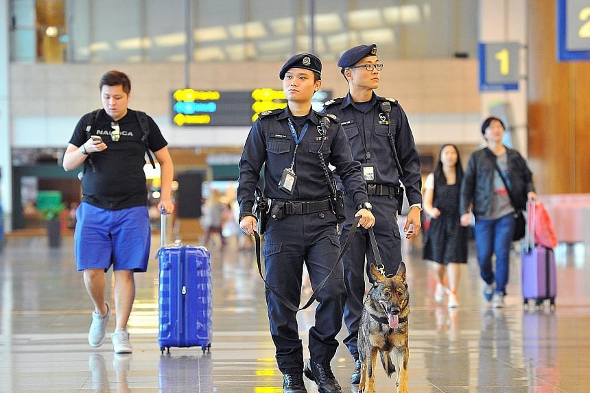 The police dog unit (above) patrolling the airport, and early-morning commuters at the Ang Mo Kio MRT station. Security and transport issues will likely figure during the campaigning for GE15.