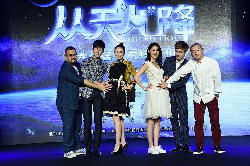 Actresses Zhang Ziyi (above) and Jiang Wen posing as pregnant women while promoting the new film Oh My God with cast and crew in Beijing early this month.