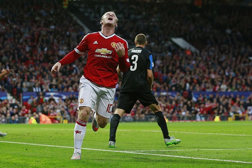 Wayne Rooney looking dejected after a missed chance in the first leg against Club Brugge. Manchester United have looked for reinforcements but Barca's striker Pedro spurned them for Chelsea.