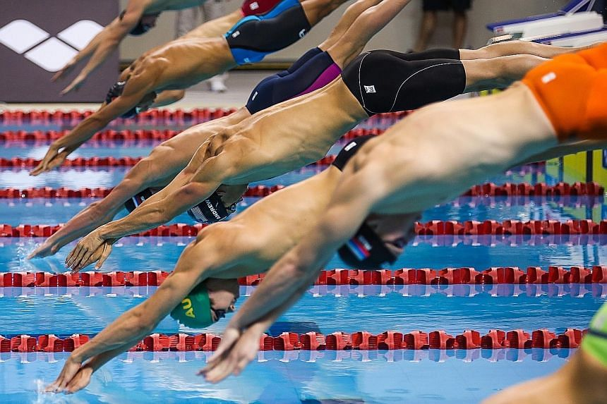 """Anton Chupkov of Russia (fourth from front) en route to winning the men's 100m breaststroke semi-final last night in 1min 00.34sec. """"I will do my best to go under the one-minute mark,"""" he said of today's final."""