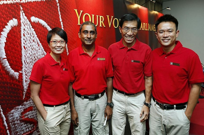 SDP secretary-general Chee Soon Juan (third from left) and chairman Jeffrey George flanked by Ms Chong Wai Fung and Mr Khung Wai Yeen, the party's candidates in the election. Last night, Mr Khung was seen on a walkabout in Marsiling-Yew Tee GRC and M