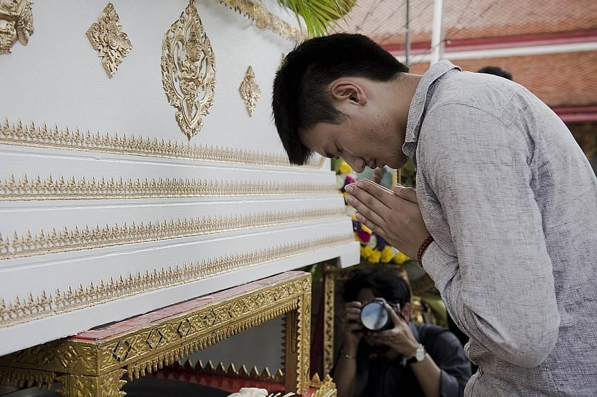 The funeral in Bangkok of Chinese tourist Gao Yu Zhu, who was killed with her mother in the Aug 17 bombing. Many of the 20 killed in the blast were foreigners.