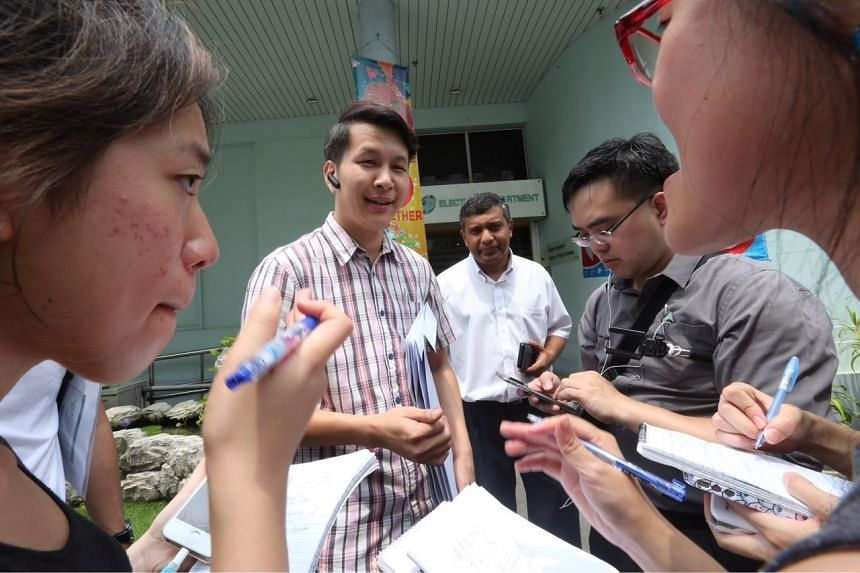 Reform Party's Andy Zhu (left) and Kumar Appavoo speaking to members of the media.