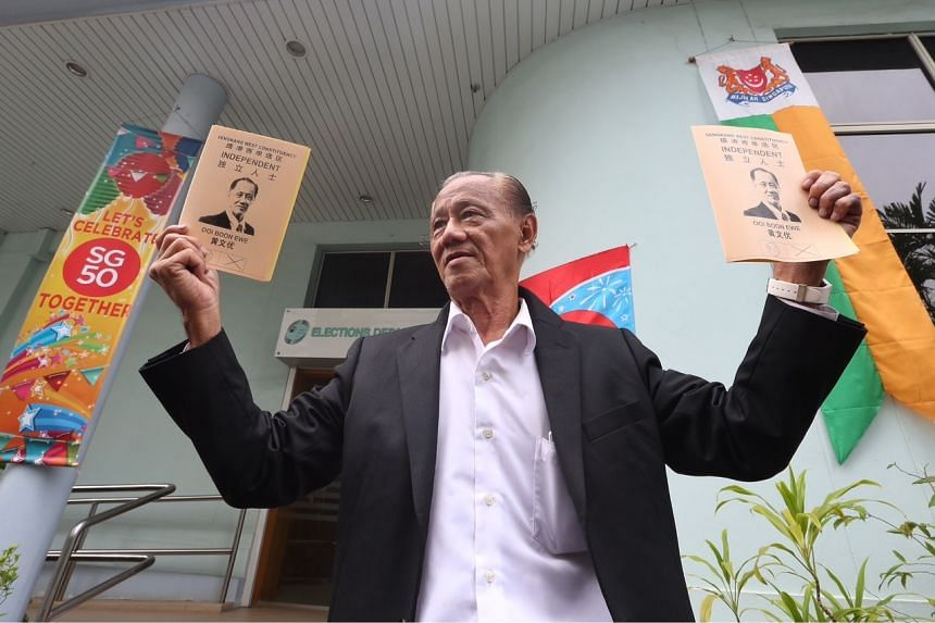 Real estate executive Ooi Boon Ewe holding up his promotional material at the ELD headquarters. Mr Ooi, 74, intends to contest in Sengkang West SMC.