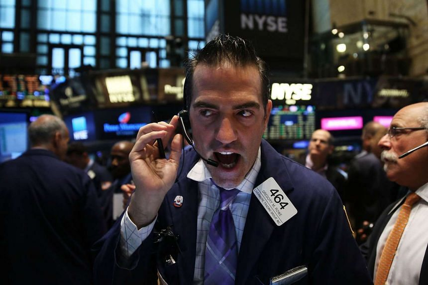 Traders working on the floor of the New York Stock Exchange on Aug 25, 2015, in New York City.