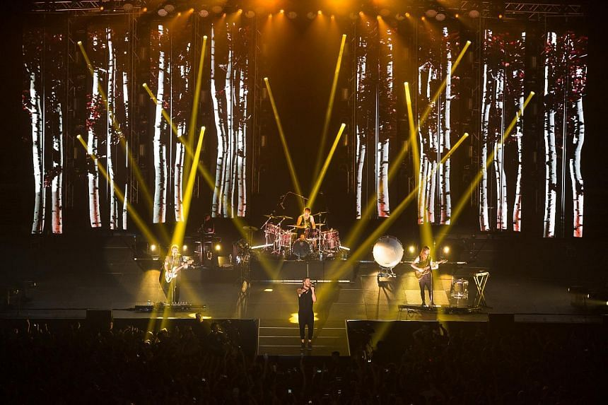 American rock band Imagine Dragons performing at the Singapore Indoor Stadium.