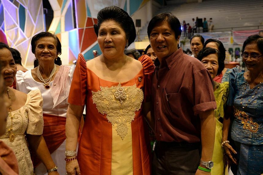 Philippine Senator Ferdinand Marcos (right) with his mother, former first lady Imelda Marcos, on July 2, 2014.