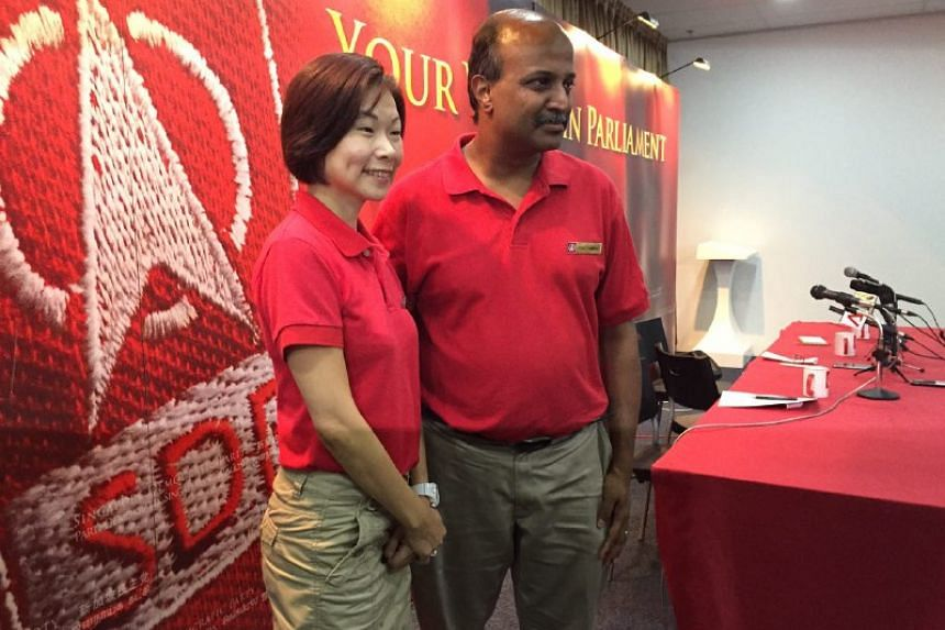Ms Jaslyn Go and Dr Paul Tambyah at a SDP press conference on Aug 26, 2015.