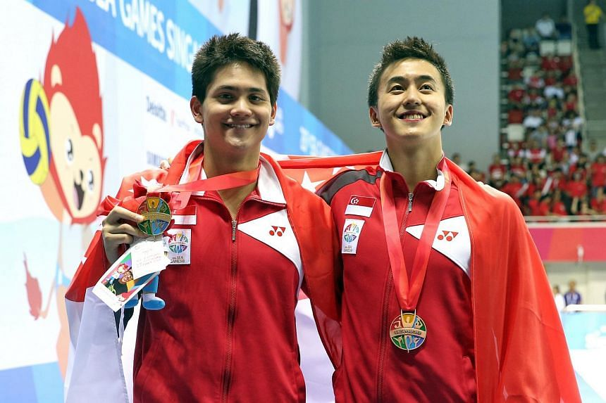Singapore's Joseph Schooling (left) and Quah Zheng Wen with their gold and bronze medals respectively from the men's 50m butterfly during the 28th SEA Games at the OCBC Aquatic Centre on June 10, 2015.