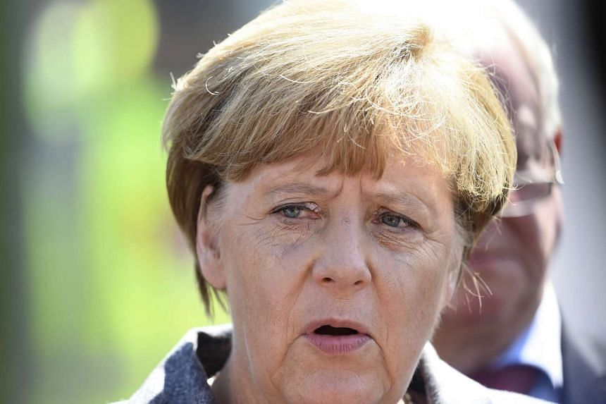 German Chancellor Angela Merkel at a shelter for asylum-seekers in Heidenau, eastern Germany on Aug 26, 2015.
