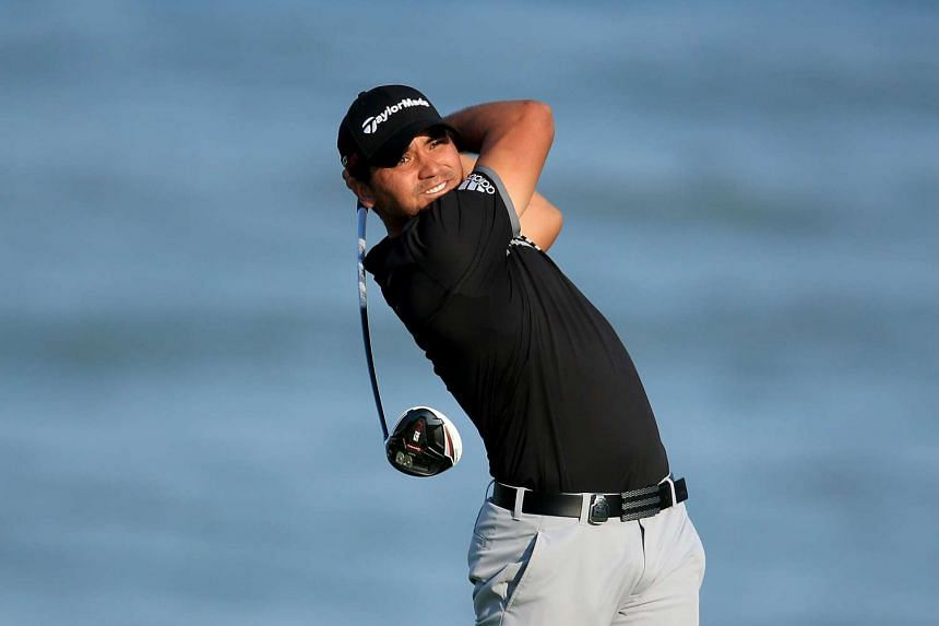 Australian golfer Jason Day plays his tee shot on the 18th hole during the final round of the 2015 PGA Championship on The Straits Course at Whistling Straits in Sheboygan, Wisconsin, on Aug 16, 2015.