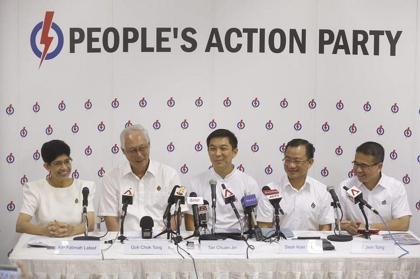 The PAP's Marine Parade GRC team (from left) Fatimah Lateef, Goh Chok Tong, Tan Chuan-Jin, Seah Kian Peng and Edwin Tong at the press conference on Aug 26, 2015.