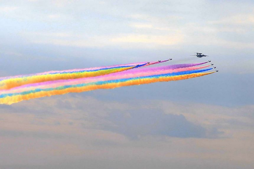 Military aircraft releasing a colourful jet stream during a rehearsal in Beijing to mark the 70th anniversary of the end of World War II. China has struggled to attract worldwide interest for the parade as world leaders are wary of the tone of the ev