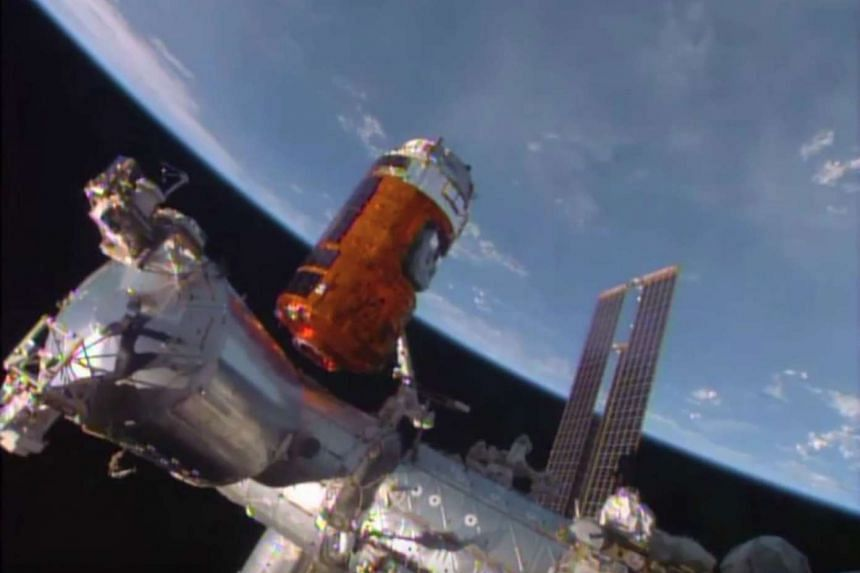 The cargo vessel Kounotori preparing to dock with the space station. Japanese drinks giant Suntory wants to test how time in a zero-gravity environment affects the flavour of whisky.