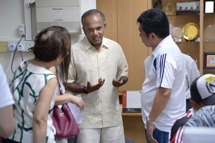 The PAP's candidate for MacPherson SMC, Ms Tin Pei Ling, with residents in Aljunied Crescent. Law and Foreign Minister K. Shanmugam (above) talking to residents at his Meet-the-People Session in Yishun Ring Road yesterday. In the past four years, the