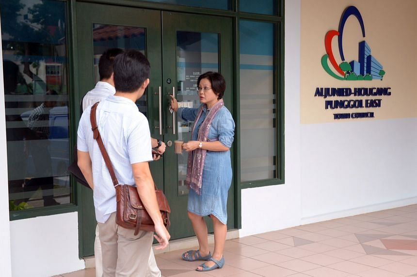 Workers' Party chairman Sylvia Lim chatting with journalists from The Straits Times outside the Aljunied-Hougang-Punggol East Town Council office.