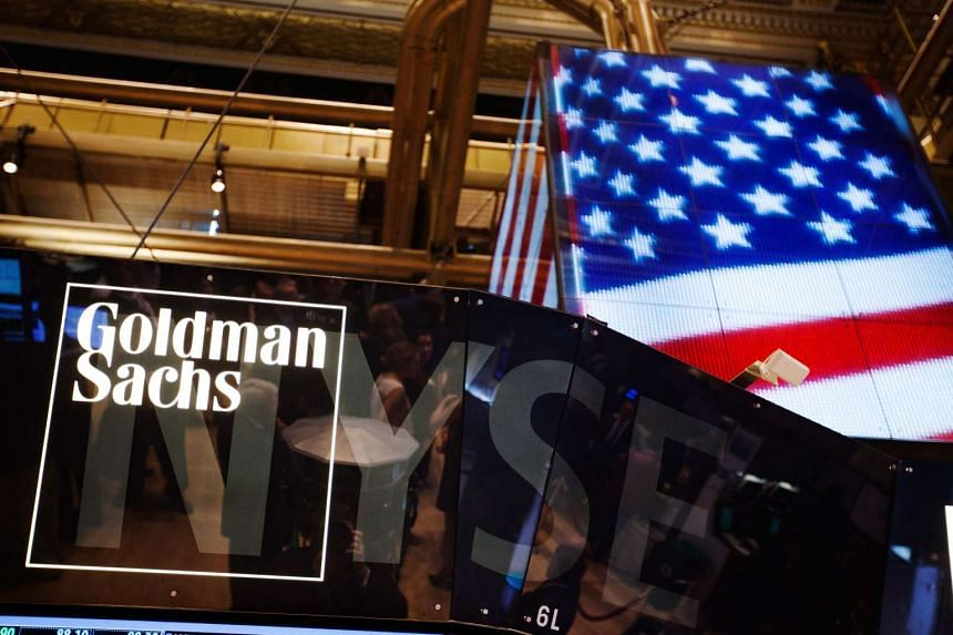 The Goldman Sachs logo is displayed on a post above the floor of the New York Stock Exchange.