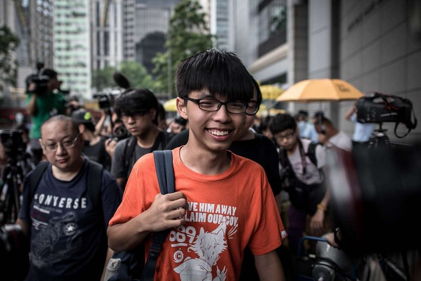 Student protester Joshua Wong arriving at the Wanchai police station in Hong Kong on Aug 27.