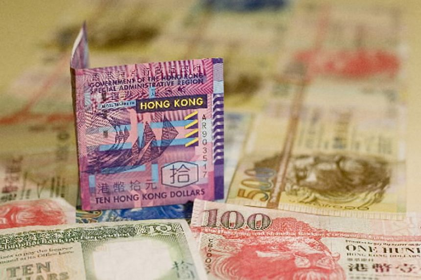 Plunging commodity prices are testing the viability of emerging currencies' long-standing pegs to the US dollar, with some already abandoned as countries balk at the cost of clinging to fixed exchange rates.