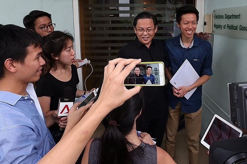 Among the potential independents at the Elections Department yesterday were: lawyer and independent candidate Tan Lam Siong (centre in black shirt).