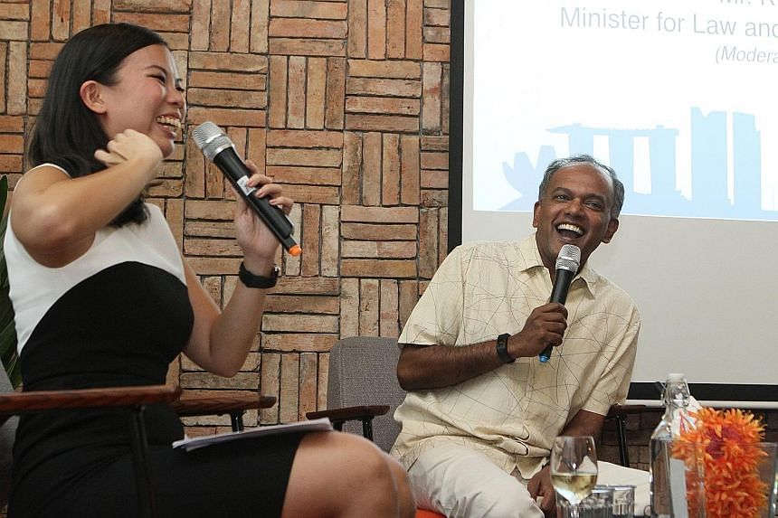 Minister for Foreign Affairs and Law K. Shanmugam sharing a light moment with Ms Grace Sai, founder and chief executive of The Hub, at the launch of the centre for start-ups on Tuesday. He said start-ups had a role to play in speeding Asean integrati