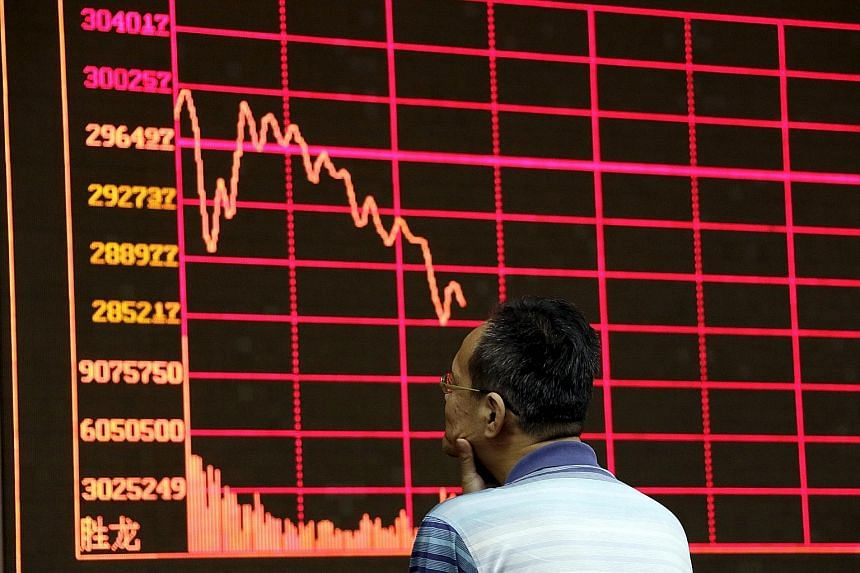 An electronic board showing Shanghai Stock Exchange information at a brokerage house in Beijing yesterday. Fears that the Chinese economy is headed for a hard landing triggered a bloodbath in global equity markets this week, prompting some analysts t
