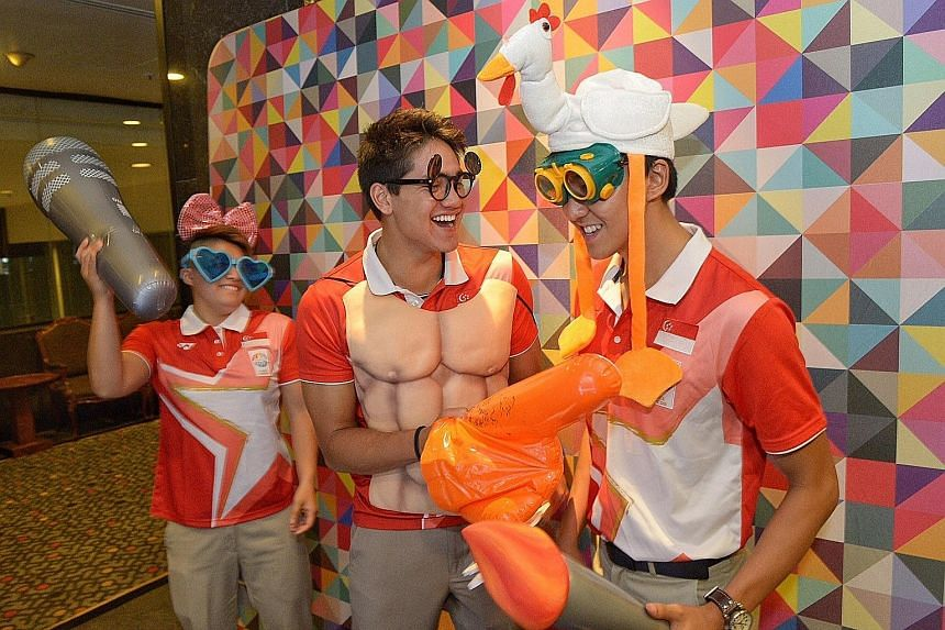 Swimmers (from left) Tao Li, Joseph Schooling and Quah Zheng Wen clowning around at an instant photo booth at the Multi-Million Dollar Award Programme presentation ceremony last night. Schooling and Quah were joint top earners, receiving cash awards