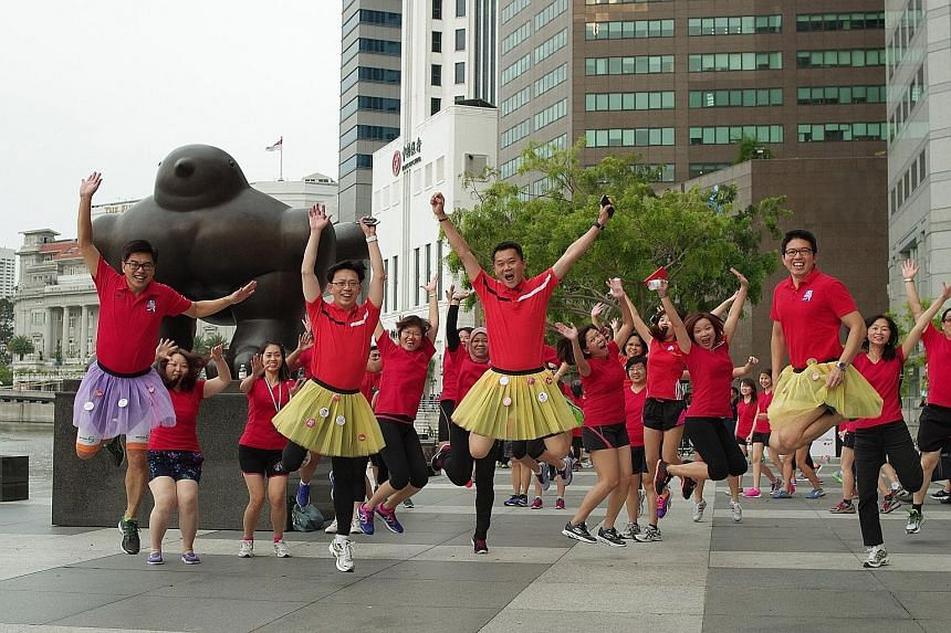 About 300 Great Eastern staff, led by chief executive officer Khoo Kah Siang, participated in a charity walk from their office at Pickering Street yesterday. Khoo, together with 10 male members of GE's senior management team, donned tutu skirts for t
