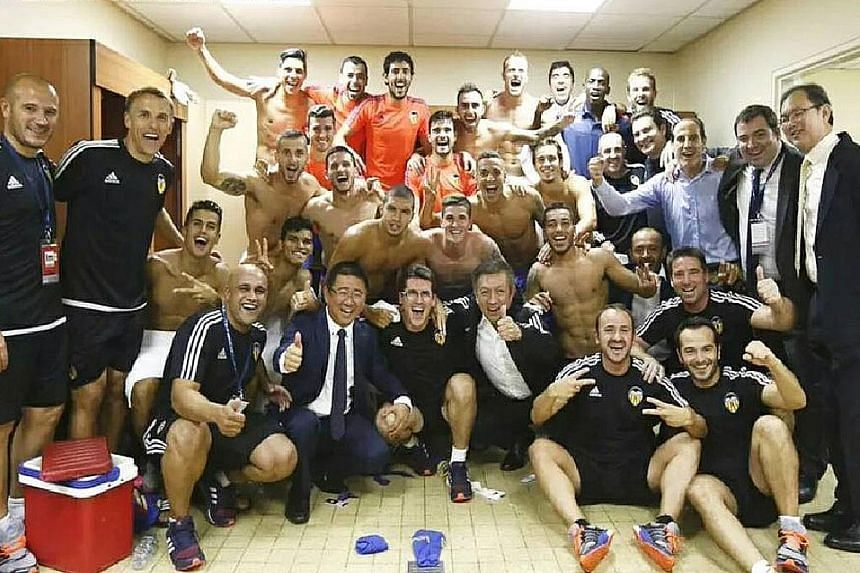 Owner Peter Lim (front row, third from right) celebrating in the dressing room with his team's members on Tuesday.