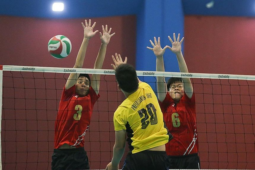 Bukit Panjang Government High (in red) came back from 11-14 to beat Presbyterian High 17-15 in the decisive fifth set.