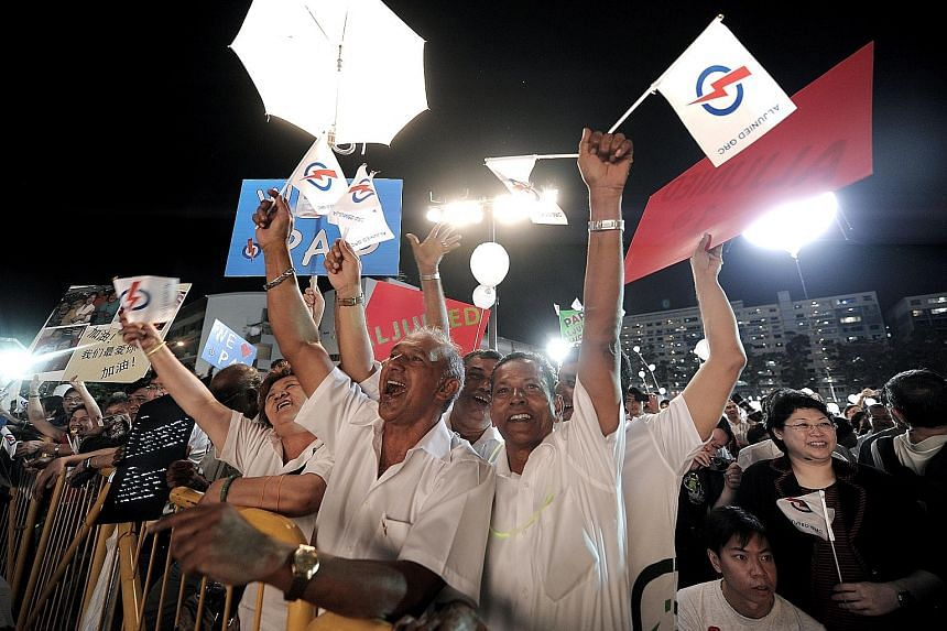 Supporters of the People's Action Party (left) and of the Singapore People's Party at the parties' respective rallies during the 2011 General Election campaign. The Elections Department yesterday asked contesting candidates in next month's polls to r