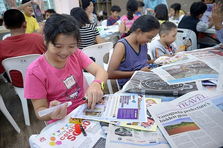 Children at Ang Mo Kio Family Service Centre - Basic enjoying their financial literacy lesson which comes in the form of scrapbooking activities based on material from The Straits Times.