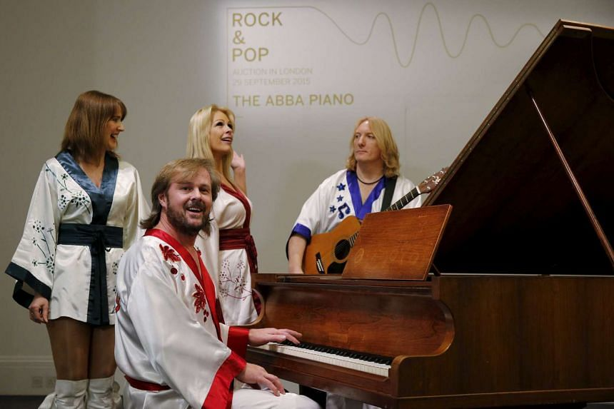Cast members of the Abba-inspired musical Bjorn Again perform at the Georg Bolin grand piano used in Abba hits.
