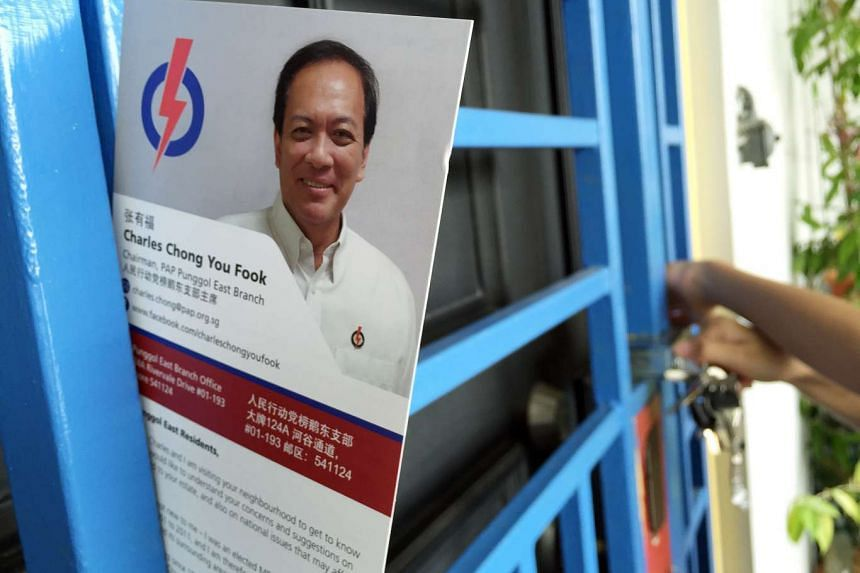 A card carrying a message from Mr Charles Chong slotted in the metal gates of a home in Punggol East.