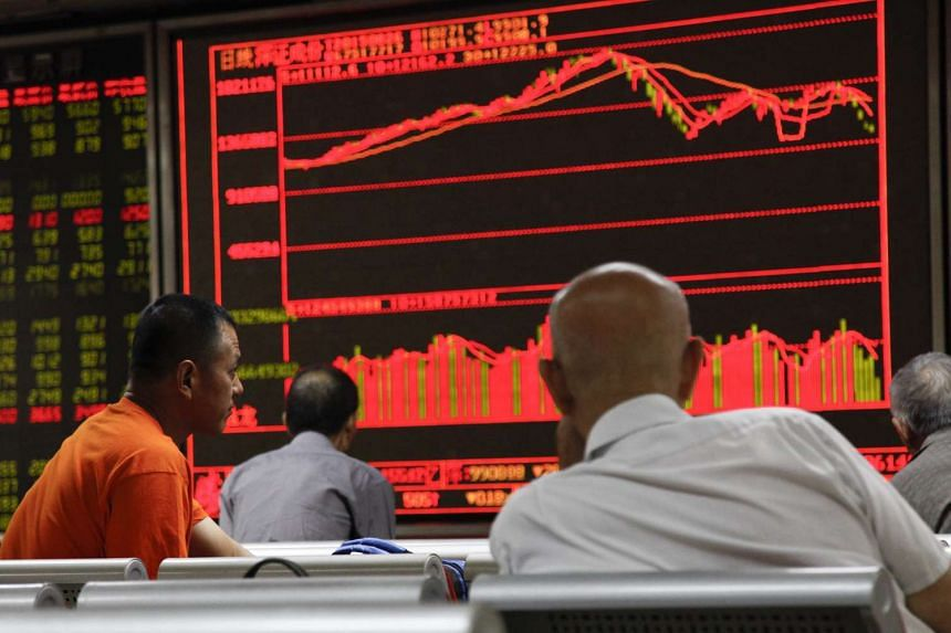 Investors monitor stock data on an electronic board at a securities brokerage house in Beijing, China, on Aug 26, 2015.
