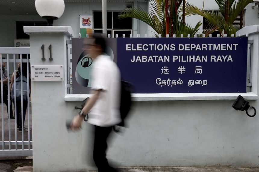 A man walking past the signboard in front of the Elections Department building in Singapore, on Aug 26, 2015.