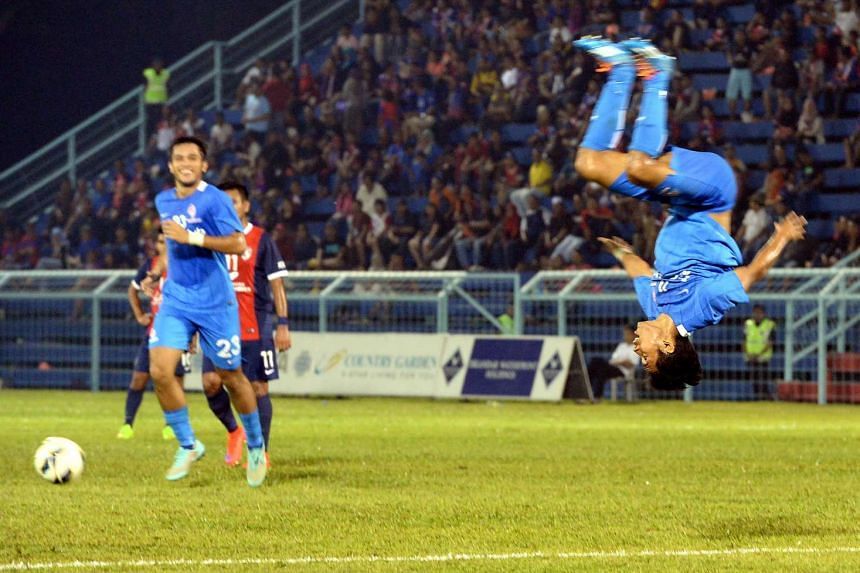 Muhammad Nazrul Nazari celebrates after scoring LionsXII's second goal against Johor Darul Takzim II (JDTII) in the second Leg of the Malaysia FA Cup quarter-final match held at the Corporation Stadium in Pasir Gudang, Johor.