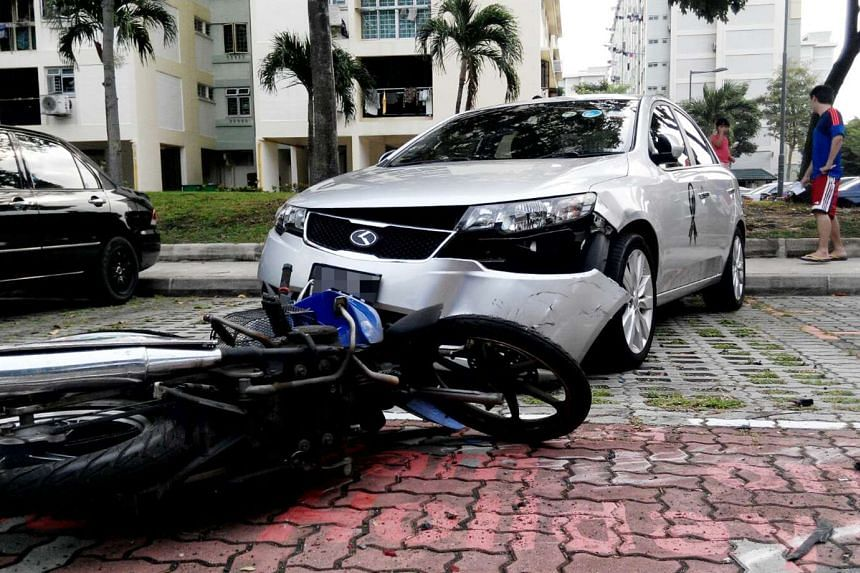 A red car knocked down three motorcycles and crashed into two other cars at a Bedok North carpark on Aug 27, 2015.