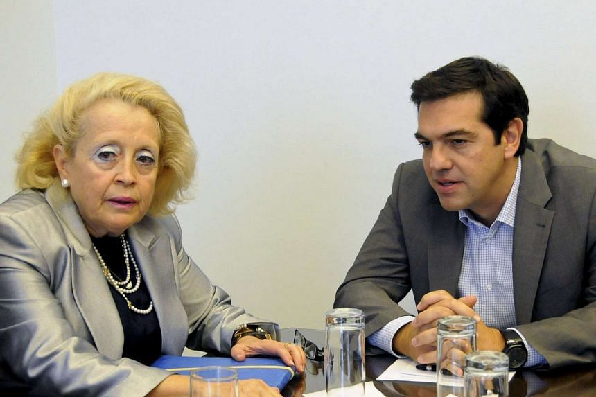 Outgoing Greek PM Alexis Tsipras and Supreme Court judge Vassiliki Thanou at a meeting in Athens in 2014.
