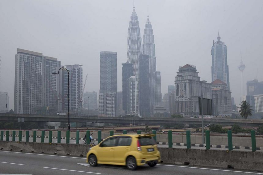 Malaysia's Petronas Twin Towers and surrounding buildings shrouded by thick haze in Kuala Lumpur on Aug 25, 2015.